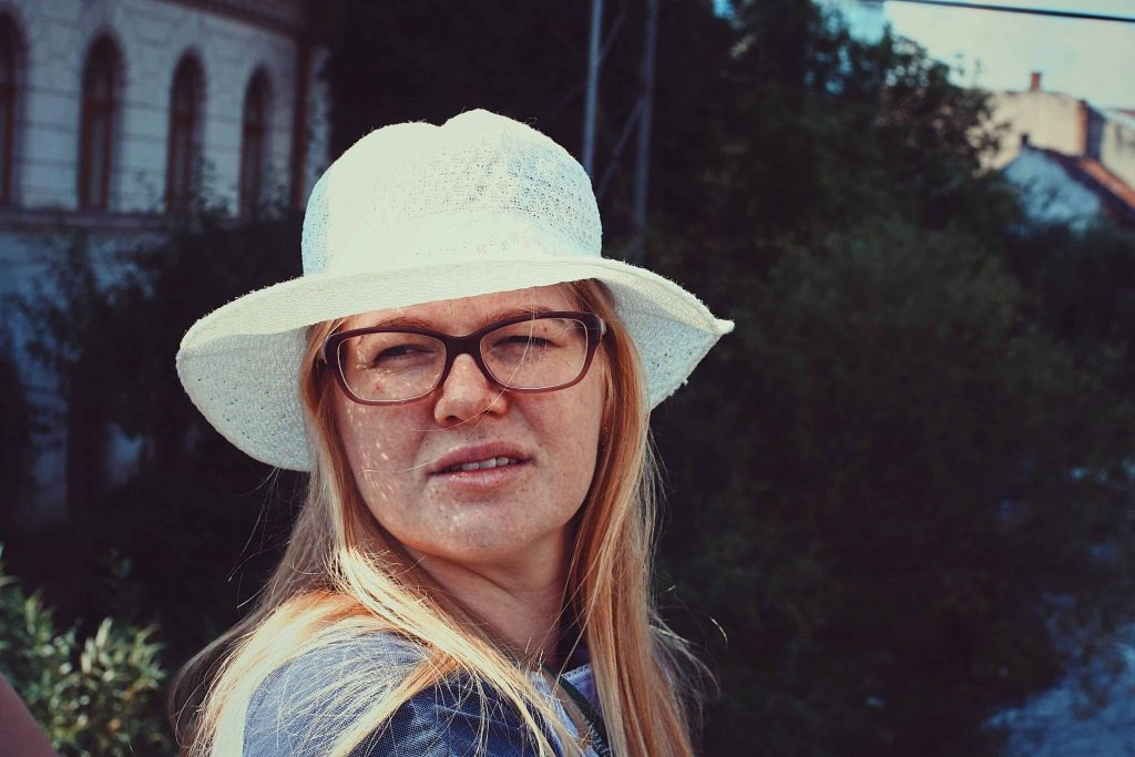 Picture of a woman squinting.